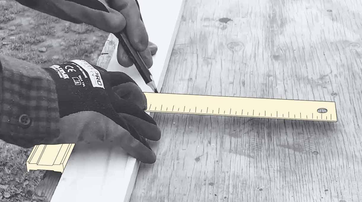 medida de la madera con una escuadra y lápiz para cortarla