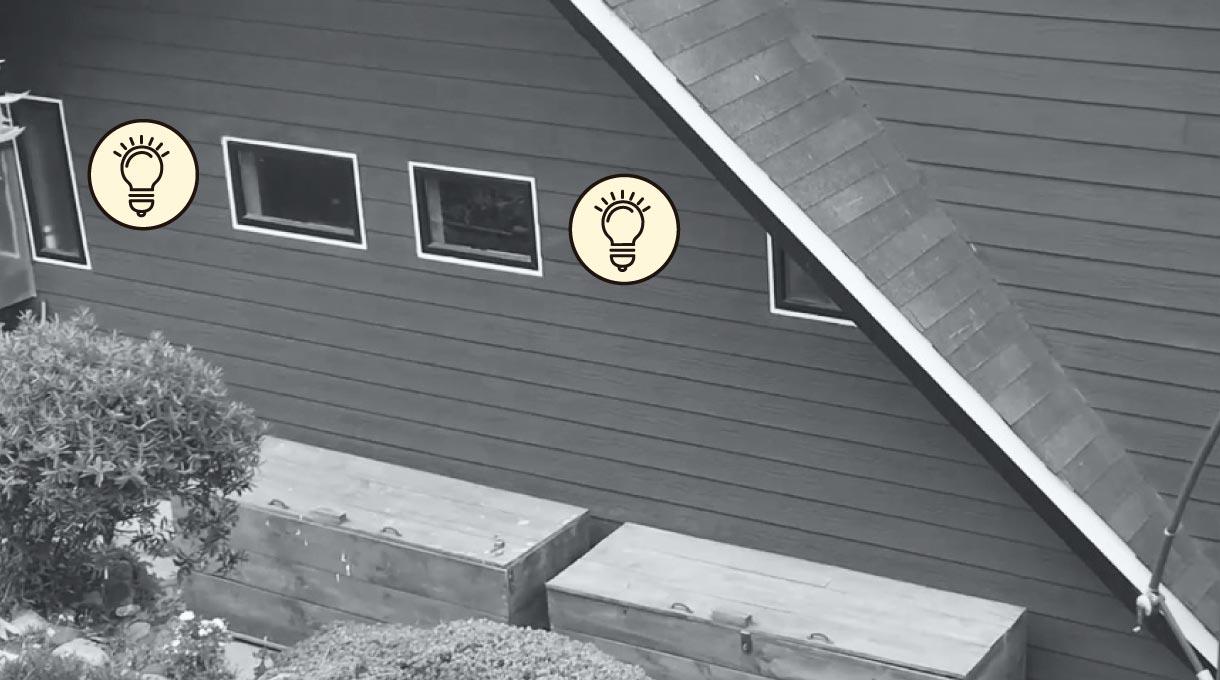 fachada exterior de una casa con faroles solares en la pared