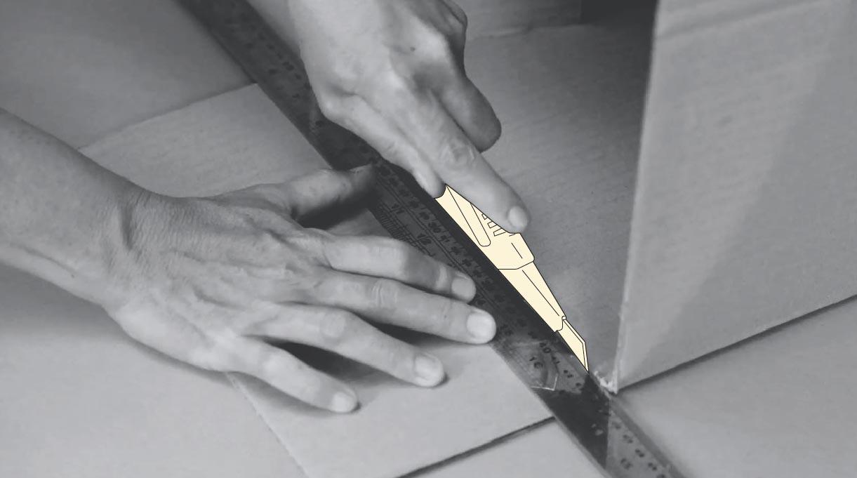 cortar aleta con cuchillo cartonero