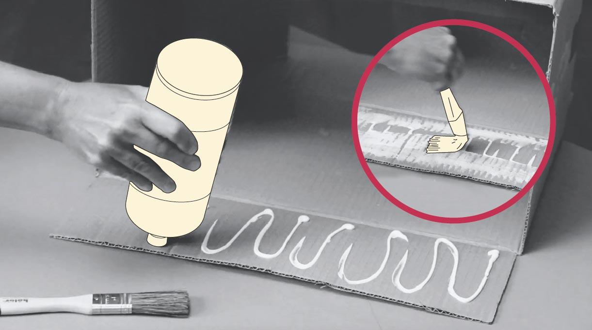 aplicar pegamento en una aleta de la caja