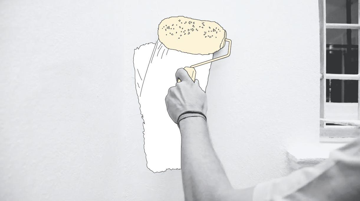 pintando el muro con rodillo
