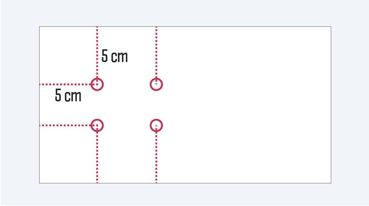 marcas en la base para hacer las perforaciones
