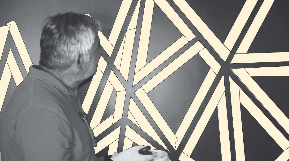 hacer patrón geométrico en muro con cinta de enmascarar