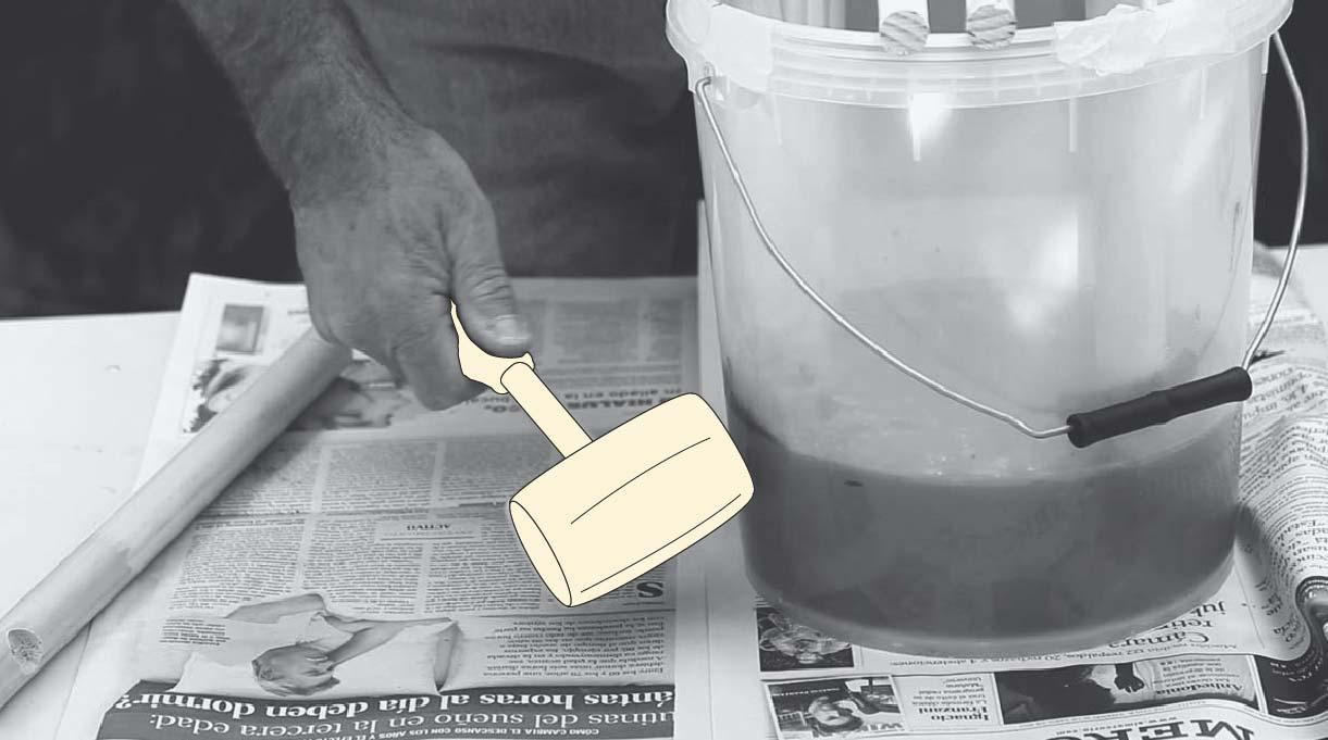 golpear el tarro con un martillo de goma para eliminar las burbujas dentro del cemento
