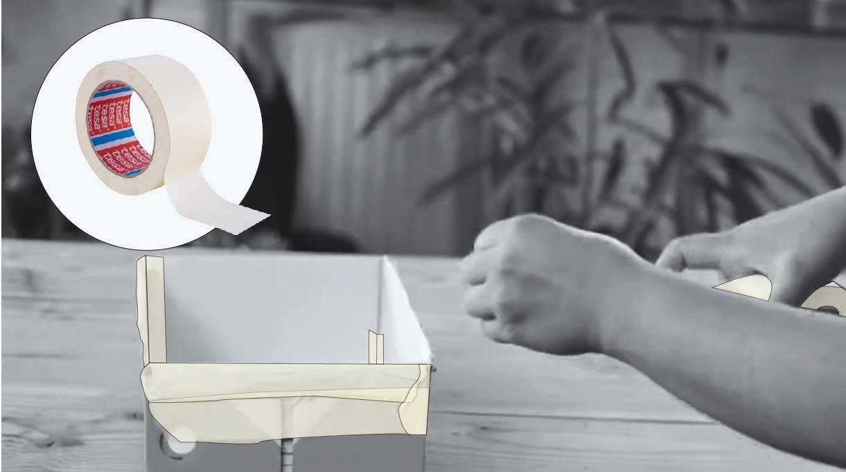 preparar los moldes reforzando uniones y pliegues de cajas de cartón con cinta para enmascarar
