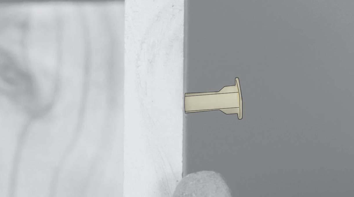 tarugo palomita introducido en el muro hasta la mitad