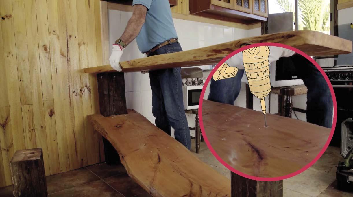 Usar el taladro inalámbrico para quitar las fijaciones que mantienen la mesa pegada al muro y las del tablón y pata del medio